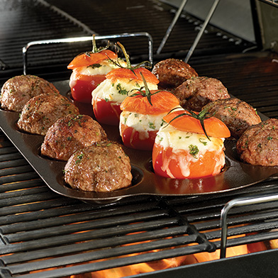 roasted tomatoes and meatballs on a grill