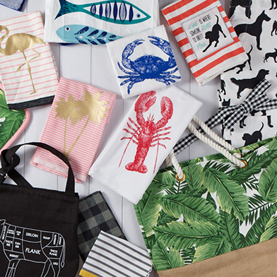 Kitchen towels and beach bags with summer designs on them
