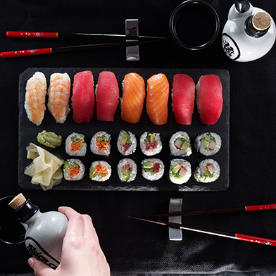 a variety of sushi on a platter